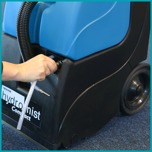 emptying carpet extractor